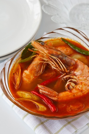 Thai traditional and popular dish ,Sour and spicy shrimp soup (Tomyum Kung) Stock Photo - 13102232