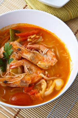 thai noodle soup: Thai food , Noodles in Sour and spicy shrimp soup (Tomyum Kung) Stock Photo