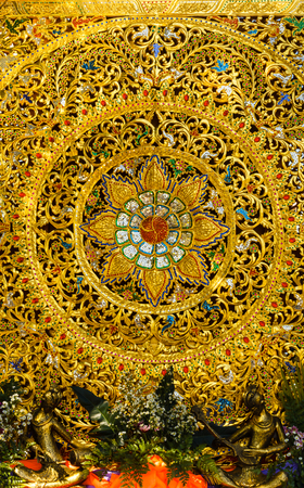 Traditional Northern Thai style pattern decorative  Woodcraft with gold paint  photo
