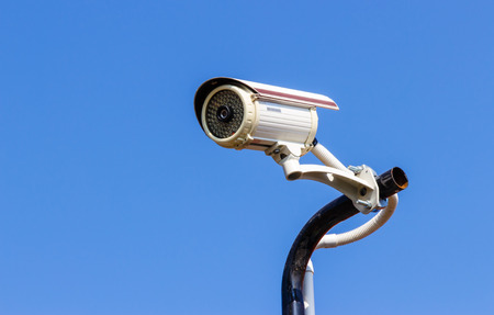 nightvision: Security CCTV camera on blue sky background.