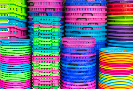plastic: A stack of colorful recycled plastic buckets on display at a sundry store.