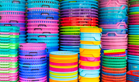 sundry: A stack of colorful recycled plastic buckets on display at a sundry store.
