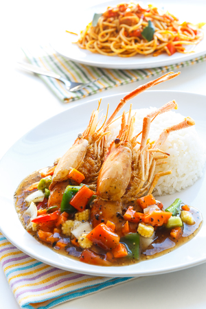 spicy cooking: Thai food, Deep-fried prawns with black pepper sauce served with rice.