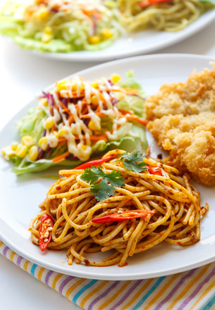 thai chili pepper: Italian Thai Fusion food, Thai red curry  spaghetti with fried fish. Stock Photo