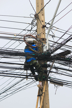 outage power: Utility workers repair power lines from the safety