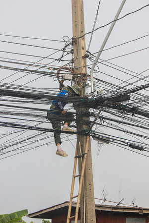 linemen: Utility workers repair power lines from the safety