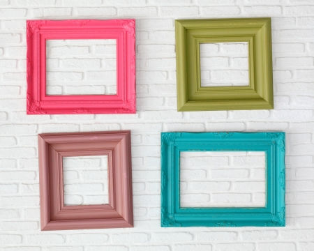 light green wall: four photo frames on the white wall  Stock Photo