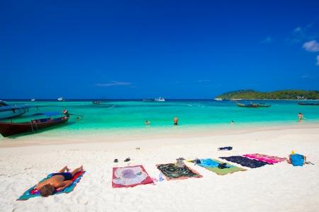 people relaxing on a Bundhaya beach koh lipe thailand  Stock fotó