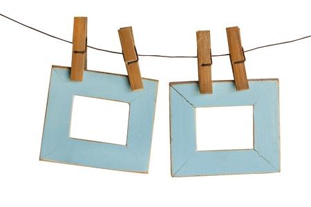 clothes peg: blue photo Frames Hanging Isolated on White background