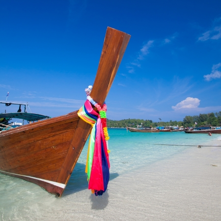 long-tailed boat on Bundhaya beach Koh LIPE Thailand  photo