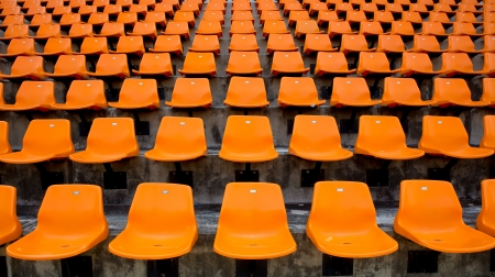 Orange empty stadium seats in arena  photo