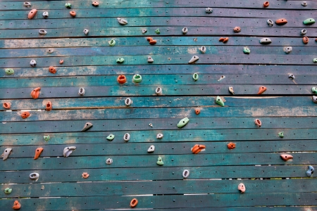 climbing wall: Grunge surface of an artificial rock climbing wall with toe and hand hold studs. Stock Photo