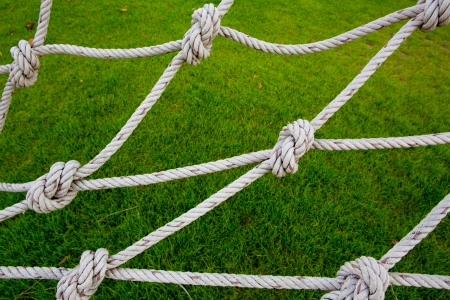 gibbet: Knot rope netting with a green background.