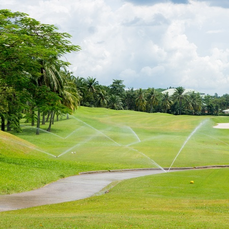 Watering in golf course photo