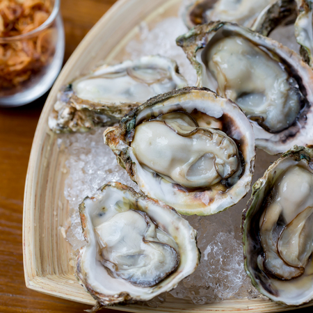 Oysters in a plate with ice Stock fotó