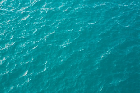 Blue sea surface with waves photo