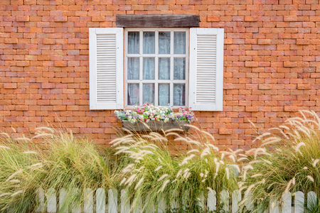 Open Window With On red brick Wall photo