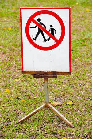 Do not step on grass in a park photo
