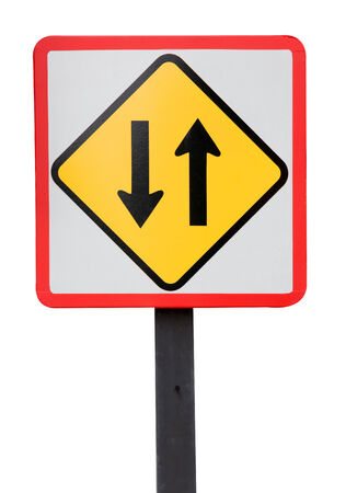 Two way traffic sign on white photo