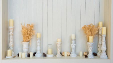 scented: scented candles on white wooden background