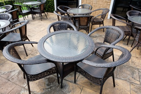 furnishings: Chairs and tables of a restaurant seating outside Stock Photo