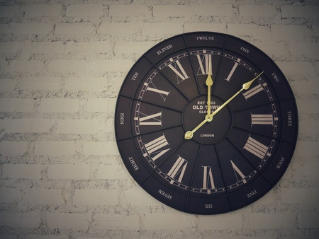style: Antique clock retro style hanging on white brick wall