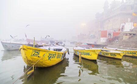 varanasi: Varanasi ,India . december2014 . Many tourist boats docking on the sacred Ganges river in Varanasi, Uttar Pradesh, India.