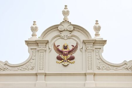 ancient creature: A Garuda, ancient budhist mythical creature on the roof at the Grand Palace in Bangkok.