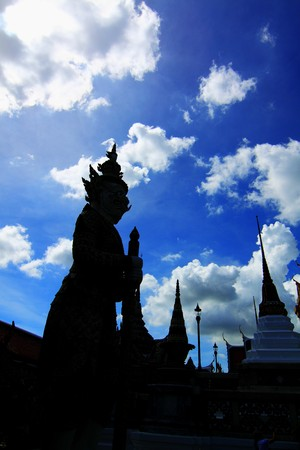 Giant Statues Silhouette, at the emerald buddha temple, Bangkok, Thailand photo