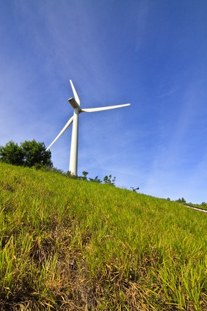 Wind turbine with blue sky background Stock Photo