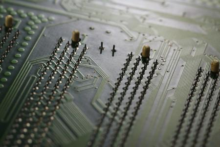 Green electronic circuit close-up photo