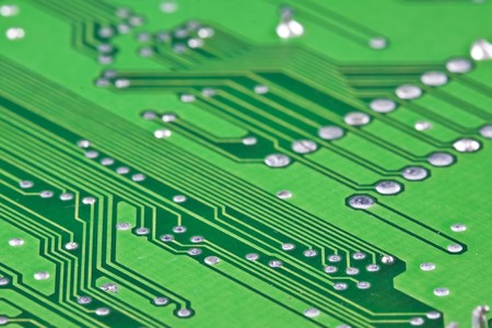 Green electronic circuit close-up photo