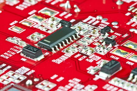 Red electronic circuit close-up