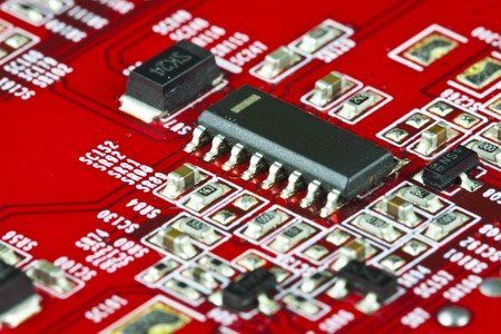 Red electronic circuit close-up photo