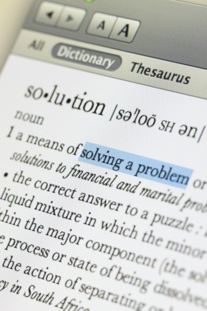 Meaning of solution in online dictionary and hilight at solving a problem word Stock Photo - 7445799