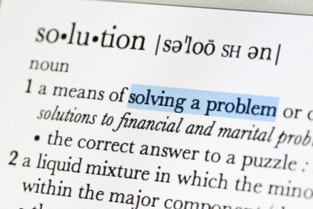 Meaning of solution in online dictionary and hilight at solving a problem word