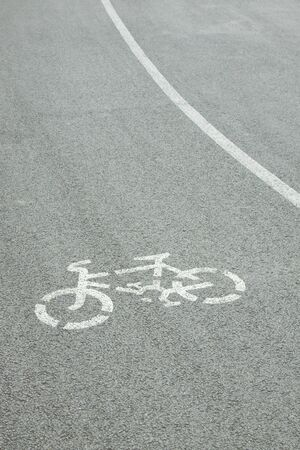 Bicycle road sign painted on the pavement  photo
