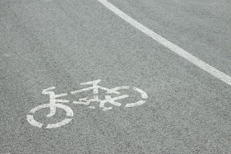 lane: Bicycle road sign painted on the pavement  Stock Photo