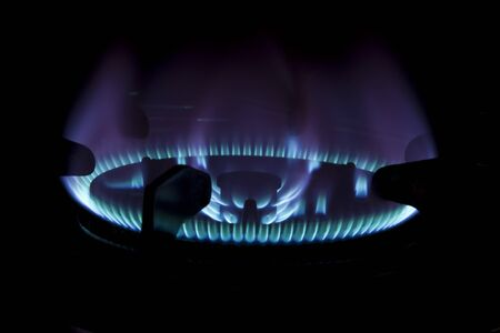 Blue flame of gas on a cooker photo