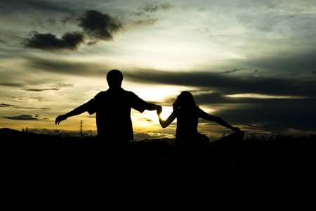 Silhouette of couple at sunset Stock Photo - 7825290
