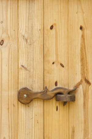 closed lock: The closed lock on a wooden door  Stock Photo