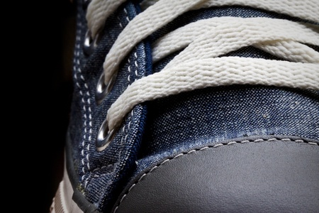 Closeup blue sneaker and white shoelace