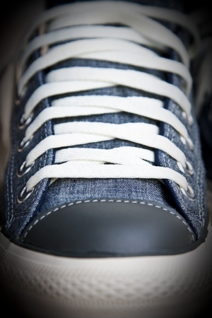 Closeup blue sneaker and white shoelace photo
