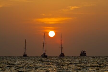 Sailing boat silhouette on a background of a beautiful sunset.