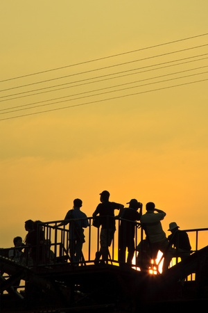 Tourist silhouette, Kwai river bridge, Kanchanaburi Province, Thailand  Banco de Imagens