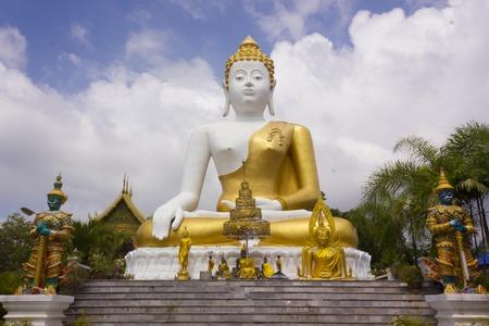 sainthood: Buddha image at Wat Pha That Doi Khum, Chiang Mai Thailand