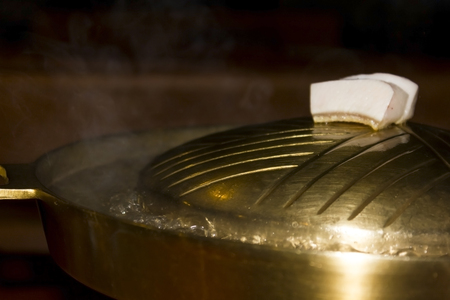 Hot pot less commonly steamboat, refers to several East Asian varieties of stew, consisting of a simmering metal pot of stock at the center of the dining table  While the hot pot is kept simmering, ingredients are placed into the pot and are cooked at the photo