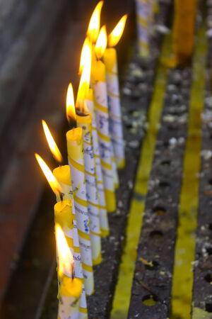 Candles for buddhism worshiping of wat phradhart lampangluang at lampang , temple in Thailand. photo
