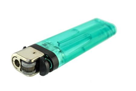 butane: A used butane green lighter - Green lighter isolated on the white background.
