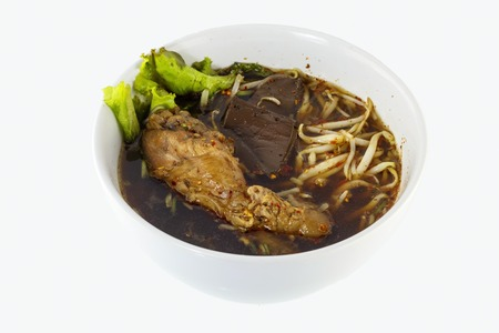 Thailand soup, an ethnic meal of chicken soup, broth, bean sprouts, noodles and basil or cilantro floating on top. photo